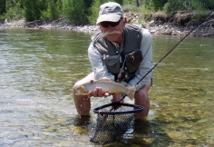 Buchner prepares to return a Snake River cutthroat to the fast-moving water after a student has caught it on an insect-imitating fly. Buchner is both a fly-fishing guide and former member of the U.S. Fly Fishing team, which participates in international, Olympics-style competition. Photo by Leslie Mertz, inset courtesy of Jay Buchner.